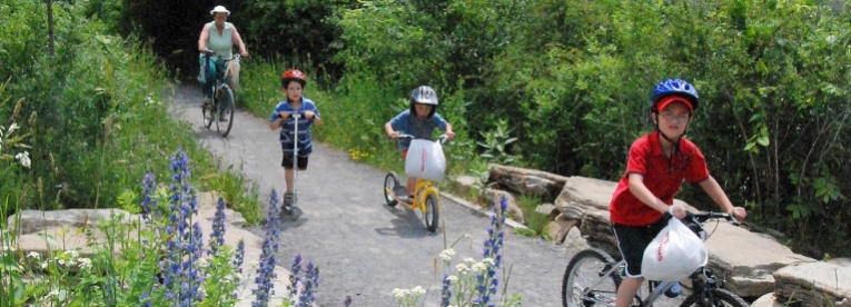 Family cycling along trail in Carleton Place